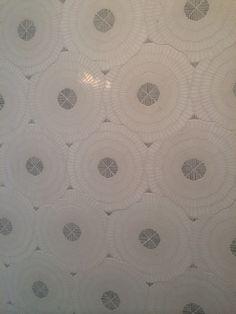 Gorgeous tile mosaic featured inside a shower wall - Ann Sacks?