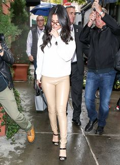 Instead of the standard black leather look, Selena Gomez dared to experiment with a nude pair by Wolford that she styled with a white sweater, maroon frames, and black sandals.