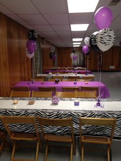 Purple & Zebra tables decorated for a baby girl shower