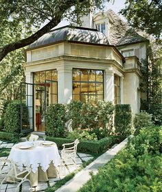 French architectural home and backyard