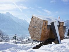 strange tiny home covered in snow