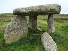 LANYON QUOIT| 2 miles south-east of Morvah, Cornwall: 'It collapsed in a storm in 1815 and was re-erected 9 years later. As a result the dolmen is now very different from its original appearance. Lanyon Quoit is located northwest of Penzance on the road between Madron and Morvah. It stands 50 metres to the east of the road. 700 metres to the west lie the remains of another dolmen known as West Lanyon Quoit.' ✫ღ⊰n