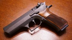 Jericho 941 with wooden grips.