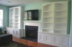 built-in entertainment center with fireplace. need for my living room but with a beefier fireplace and more shallow cabinetry