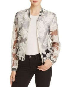 Throwback bomber jackets are here to stay. Lucy Paris keeps it fresh with this sheer, floral-printed rendition, trimmed with sporty stripes in homage to its varsity provenance. | Polyester; trim: poly