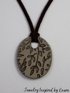 Stamped Polymer Clay Pendant on leather. By Heather Kittredge