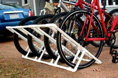 As mentioned before, I made a bike rack for the porch today. I was looking for a cheap-o way to tidy up the porch. All the similar floor rac...