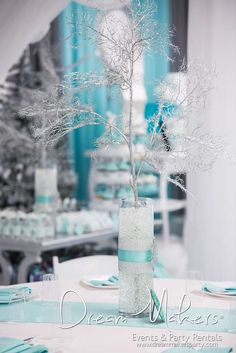 Snowy branch centerpieces at a winter birthday party!  See more party planning ideas at CatchMyParty.com!