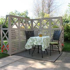 Create a seating nook in your outdoor space for the next get together with this trellis by Yardistry.