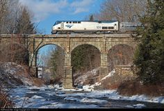 The recently rerouted Vermonter crosses the classic stone bridge over the Fall River on a cold Saturday afternoon. The bridge is on the former Boston & Maine Conn River Line that hosted the Amtrak Montrealer until deteriorating track conditions forced its cancellation in 1987. On December 28th, 2014 the Vermonter was moved back to this recently rebuilt line after running on a Central Vermont/New England Central routing just to the east of here since 1989.