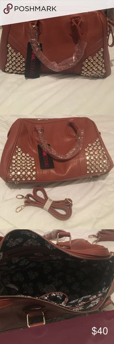 ‼️SALE‼️New Handbag 👜 New gorgeous brown handbag. Pretty detailed gold studs on bottom corners in the front. Has a black and white fabric on the inside. Comes with detachable arm strap. Very spacious inside 🚫No Trades Bags