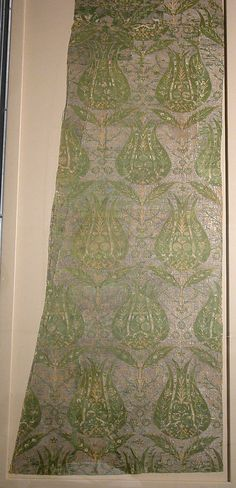 Fragment Date: 16th century Geography: Turkey, Bursa Culture: Islamic Medium: Silk, metal wrapped thread; lampas (kemha) Dimensions: Textile: H. 52 in. (132.1 cm) W. 21 3/4 in. (55.2 cm) Mount: H. 58 1/2 in. (148.6 cm) W. 26 5/16 in. (66.8 cm) Classification: Textiles-Woven