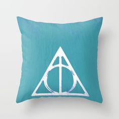 Deathly Hallows - Blue Throw Pillow by Phoenix Prints. Worldwide shipping available at Society6.com. Just one of millions of high quality products available.