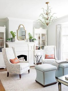 Love the ottomans and what I can see of the coffee table - Touch of color in a neutral space.