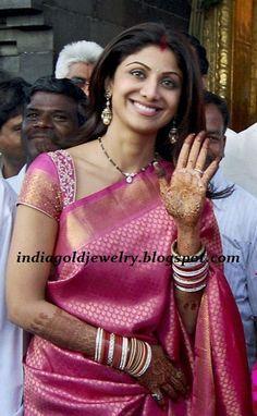 Latest Indian Gold and Diamond Jewellery Designs: Shilpa Shetty in Black beads(Nallapusalu) chain with Diamond pendant and Antique Jhumkas