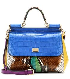 Dolce & Gabbana - Sicily Medium caiman, alligator and python leather tote - Dolce & Gabbana give us yet another desirable combination of exotic skins on the classic 'Sicily' tote. In an array of blue, yellow and green, the caiman, alligator and python skins take on a modern glamour. Style next to all-black separates for a fun dose of colour. seen @ www.mytheresa.com