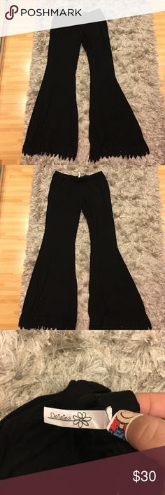 Leggings Black bell bottom stretchy lounge pants with embroidered ends. Size Large from the Daisy Shop ... excellent condition Daisies Pants Leggings