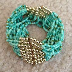 Bracelet Turquoise and gold bead Bracelet turquoise and gold tone beaded stretch multi strand bracelet. NWOT Jewelry Bracelets