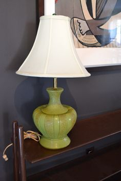 """Mid Century Green and gold Ceramic lamp with shade - $60  Beautiful Mid-Century MCM green ceramic lamp with gold details. This lamp has a shade ( you may want to change it) and a green glass ball finial. In working condition minor scratches etc. Over all displays excellent , but as with all vintage things sold """"AS IS"""" Please see images :) http://toronto.craigslist.ca/yrk/atq/5001574166.html"""