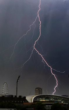 streak of lightning illuminates the sky behind the Oval as rain delays the game between England and the West Indies Weather Storm, Weather Cloud, Wild Weather, Tornados, Travel Pictures, Cool Pictures, Thunder And Lightning, Lightning Storms, Pictures Of Lightning