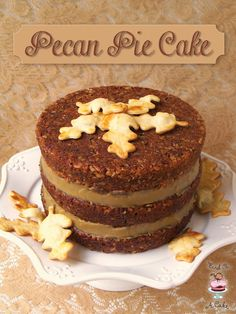 Pecan Pie Cake ~ Thanksgiving dinner always includes an array of delicious desserts. Do you have trouble choosing between a slice of cake or a piece of pie? This recipe will solve that dilemma! This delicious, moist pecan cake has caramel filling, toasted pecans and pie crust Autumn leaves. Go ahead...put it on your menu!