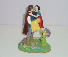 Awwww!  This is so cute :)   Walt Disney World & Resots Snow White Prince Charming Dopey Figurine