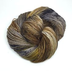 This skein has a very rustic feel to it. It has silver gray with shades of brown, and black speckles. Variations can occur between skeins since they are all dyed one by one.  It's recommended that you wash your finish item by hand and lay flat to dry. This yarn was dyed using professional acid dyes. Although I rinse my skeins well, some bleeding may occur.  I try my best to portray colors accurately. Colors on computer monitors and mobile devices may vary.    Use t...