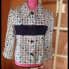 """Spring geometric print dressy short waist jacket Really smart looking.  I work it with either navy blue slack or a skirt. Large 4 button closure. Professional appearance but you could dress it down with capris or shorts. EUC. Besides navy, the background main color is off white. The circle print has red, yellow, turquoise and royal blue Measures 19"""" at the chest and 22"""" long Harve Benard Jackets & Coats"""