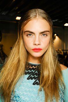 Cara Delevingne works gelled hair at Missoni