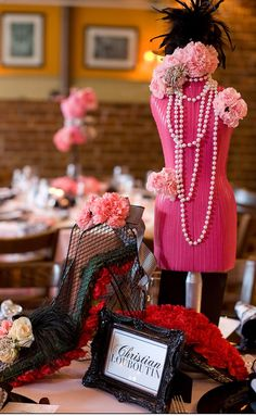 Fashion-Inspired Centerpieces Featuring Mini Mannequins | Photography: dMdC Photography. Read More: http://www.insideweddings.com/weddings/black-white-pink-fashion-themed-bridal-shower/490/