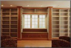 An entire wall devoted to a library (no books yet). I like the soft lighting and built in seating. Maybe I DO need to spring for custom cabinets.