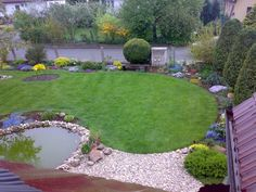 Cicular arcs at end of lawn integrates pond, paving and planting.