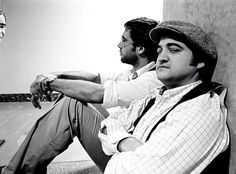 """Michael Tighe Archive """"Chevy Chase & John Belushi"""" - NEW YORK - Actors Chevy Chase and John Belushi take a break in the NBC Studios in 1976 in New York. (Photo by Michael Tighe/Hulton Archive/Getty Images) Liza Minnelli, Danny Devito, Christopher Reeve, Tony Curtis, Wayne Gretzky, Kurt Vonnegut, Liam Neeson, Fred Astaire, Robert Redford"""