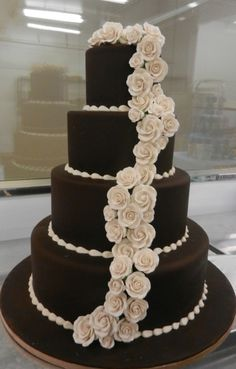 A dark fondant base with light sugar roses give a classic cake a bold look.