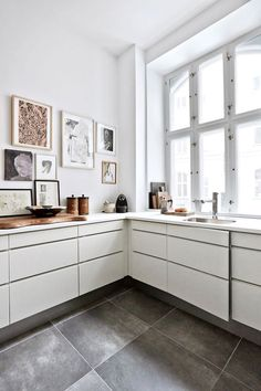 bright white kitchen with art gallery wall. / sfgirlbybay