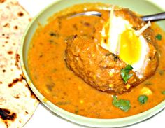 Nargisi Kofta - Eggs covered in lean ground meat and flavoured gravy
