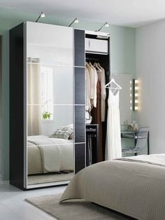 Ideas for Marky's College Bedroom Mirrored wardrobe doors, like AULI for PAX, are clever small space multi-taskers. They hide your clothes and reflect light to make your room feel larger, all while taking up no extra wall space! Ikea Wardrobe Storage, Ikea Pax Wardrobe, Ikea Closet, Bedroom Wardrobe, Wardrobe Closet, Bedroom Storage, Small Room Bedroom, Trendy Bedroom, Home Bedroom