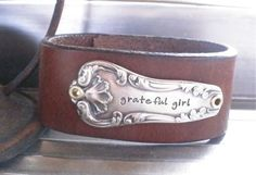 barb fredin designs GRATEFUL GIRL - Hand stamped silver flatware leather cuff. $35.00, via Etsy.