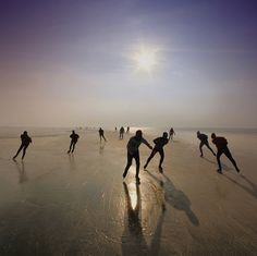 Image by Amsterdam-based photographer Ben Visbeek - Dutch ice skating on the Gouwzee, a bay in North Holland.