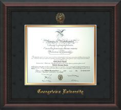 Georgetown University Diploma frame w/harwood moulding and official Georgetown seal and name embossing.  Black Suede on Gold mat.  Makes a unique and thoughtful graduation gift!