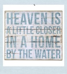 Heaven Closer sign. Heaven is a Little Closer in a Home by the Water. Weathered planked and rubbed wood creates wall art that looks aged from wind sand and sun for a beach cottage style. Designed in a box style to allow for either wall hanging or sit atop a shelf or table.