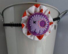 Handmade Halloween skull stretchy headband hair accessory with a fabric ruffle and cute purple felt Halloween skull. Handmade in England.