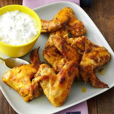 Curry & Mango Chutney Chicken Wings Recipe -We have an annual cook-off at our cabin. One time the theme was wings and ribs, so I made wings with chutney, and everyone cheered. The flavors are refreshing on warm days. —Lori Stefanishion, Drumheller, Alberta