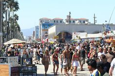 Venice Beach Boardwalk...street performers and artists, strangeness, good food, sun and sand, rich and poor, all together in a circus of life...