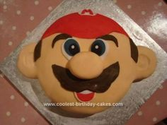 Homemade Mario Cake: After getting inspiration from this website I felt able to make my own Mario cake for a friend's son.  I made an 8 inch chocolate marble Madeira sponge