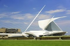 """The winglike brise-soleil of the Quadracci Pavilion at the Milwaukee Art Museum in Wisconsin has become the most iconic part of the museum's identity since it was completed in 2001. The """"wings"""" close over the structure at night or during inclement weather, shielding patrons as well as the vast collection of artwork below."""
