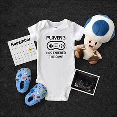 Player 3 Has Entered The Game. Cute pregnancy announcement idea. Video games, nintendo, mario, gamer pregnancy announcement. Original pregnancy announcement idea. Custom onesie. $14.95 allmyheartboutique.com