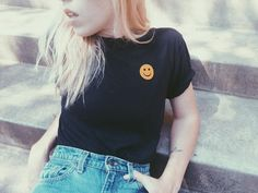 - Smiley Face Tee - Available in vintage white with red flocked lettering. - Sizes S, M, L - 50% Polyester, 50% Cotton