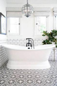remodeling bathroom ideas white tub with chandelier over