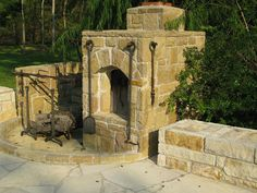 Stone smoker & rotisserie pit, just off the BBQ Patio of this Texas Hill Country style home...